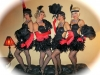 Burlesque dancers in feather dress